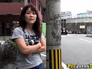 Asian pees a stream onto..