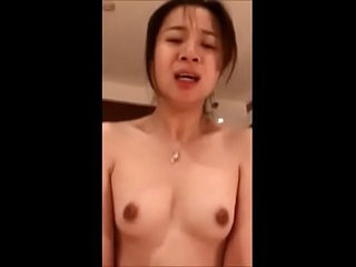 Petite Chinese girl riding..
